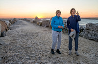 Bev and Marg on the breakwater at sunset