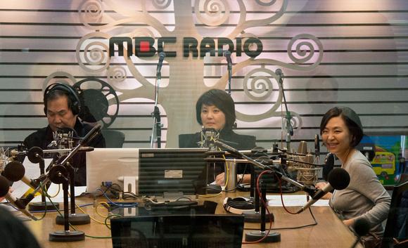 Program host, hostess and Christine
