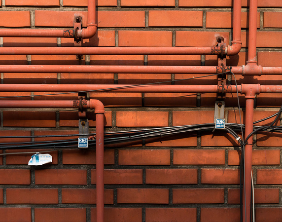 Pipes on brick wall
